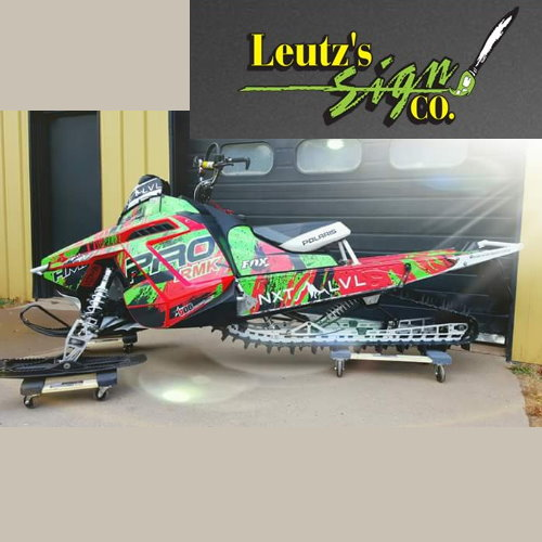 SAVE on a snowmobile wrap now before winter hits at UP Bargains
